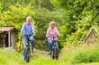 Leinwanddruck Bild - Seniors exercising with bicycle