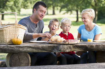 Young family enjoying a picnic together