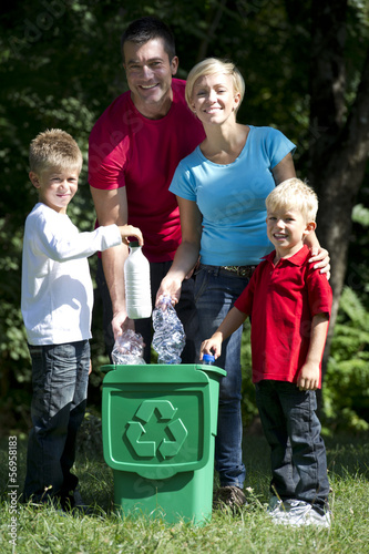 Family recycling plastic bottles