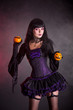 Smiling witch in purple gothic Halloween costume
