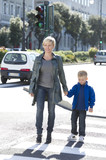 Mother and son walking across street