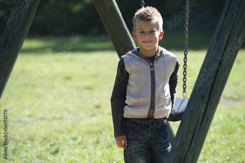 Young boy on a swing in the park