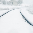 Vintage Background of Railway Covered by Snow