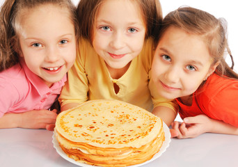 Beautiful little girls with pancakes