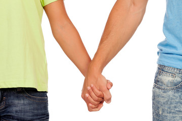 Hands clasped of two male lovers