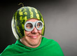 Leinwanddruck Bild - Funny man with watermelon helmet and googles