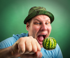 Bizarre man preparing to eat watermelon