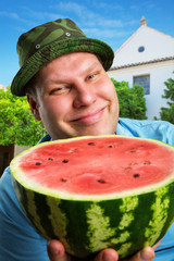 Cheerful farmer with watermelon