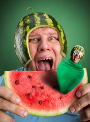 Scared man with watermelon helmet