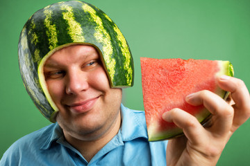 Bizarre man in a helmet from a watermelon