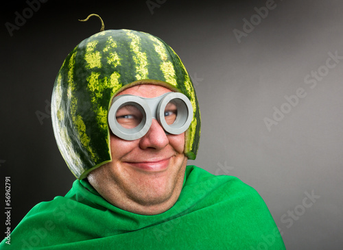 Leinwanddruck Bild Funny man with watermelon helmet and googles