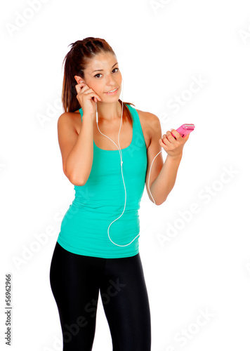 Young woman listening music with her ​​cell phone