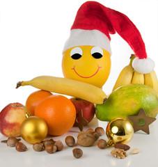 Healthy Xmas - Lustige lachende Honigmelone mit Nikolausmütze