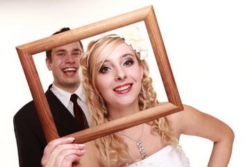 Wedding couple in the frame happy bride groom