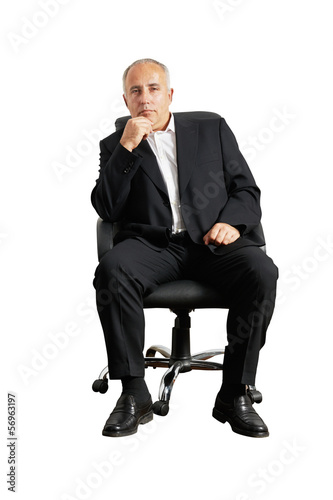 senior man sitting on office chair