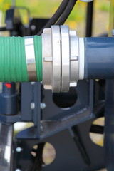 green plastic hose tube is connected to blue steel pipeline