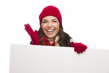 Thrilled Girl Wearing Winter Hat and Gloves Holds Blank Sign poster