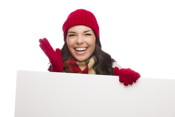 Thrilled Girl Wearing Winter Hat and Gloves Holds Blank Sign