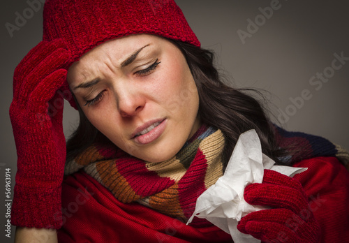 Miserable Mixed Race Woman Blowing Her Sore Nose with Tissue