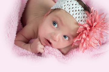 pretty blue eyed baby wearing a flower headband