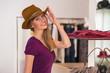Beautiful woman shopping in clothing store