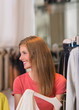 Authentic beautiful woman shopping in clothing store