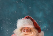 Magical portrait of Santa Claus in snowfall at North Pole