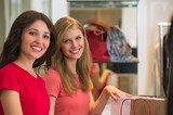 Two young women shopping in mall