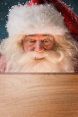 Santa Claus Opening Christmas magic concept