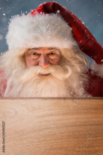 Santa Claus Opening Christmas magic concept