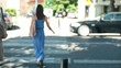 Woman crossing the street in the city, steadicam shot