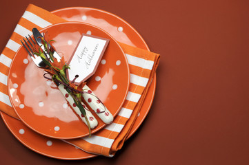 Halloween orange table setting with copy space