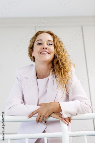 Portrait of happy businesswoman in office