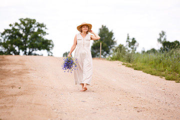 Women on country road with flowers