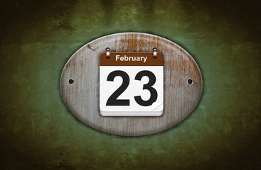 Old wooden calendar with February 23.