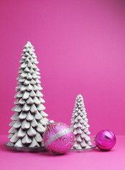 White Christmas trees and pink baubles festive decorations