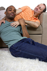 two gay lovers relaxing at home in the livingroom