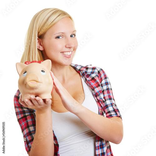 Lachendes Mädchen mit Sparschwein