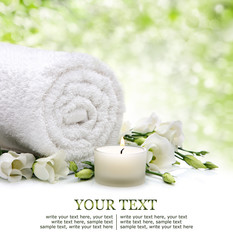 Spa bacground with towel and flowers and candlelight