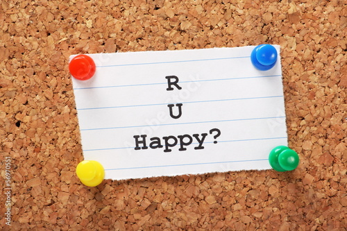 Are You Happy note pinned to a cork board