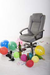 Office swivel chair and aftermath of an office party