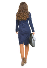 Full length portrait of business woman with briefcase