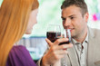 Handsome man having glass of wine with his girlfriend