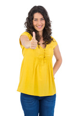 Smiling casual young woman posing thumbs up