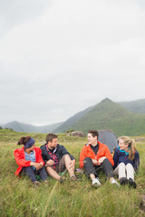Friends talking together on a camping trip