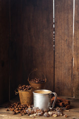 Coffee in aluminum mug with cinnamon and brown sugar