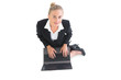 Smiling young businesswoman sitting on floor
