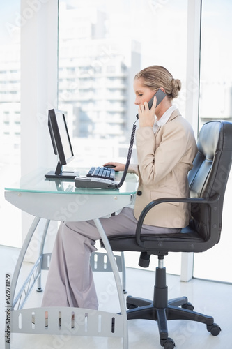 Focused blonde businesswoman on the phone