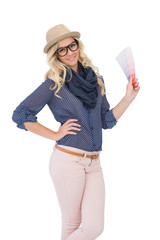 Smiling trendy blonde with classy glasses holding color chart