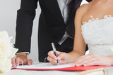 Close up of young bride signing wedding contract